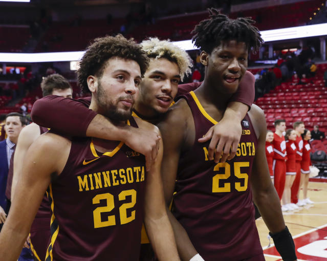 Minnesota's Gabe Kalscheur (22), Jarvis Omersa and Daniel Oturu (25) walk off the court after Minnesotan defeated Wisconsin 59-52 in an NCAA college basketball game Thursday, Jan. 3, 2019, in Madison, Wis. (AP Photo/Andy Manis)