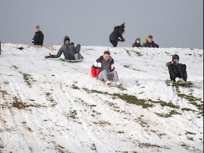 <p>Sledging on Wychbury Hill in Hagley, Worcestershire</p> (PA)