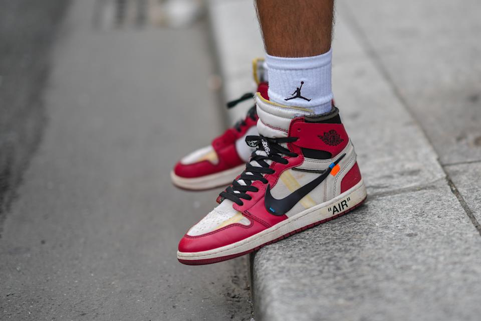 PARIS, FRANCE - JUNE 23: Marc Forne wears white ribbed Air Jordan socks from Nike, black / white and red leather Air Jordan sneakers from Nike, outside BLUEMARBLE, during Paris Fashion Week - Menswear Spring/Summer 2022, on June 23, 2021 in Paris, France. (Photo by Edward Berthelot/Getty Images)
