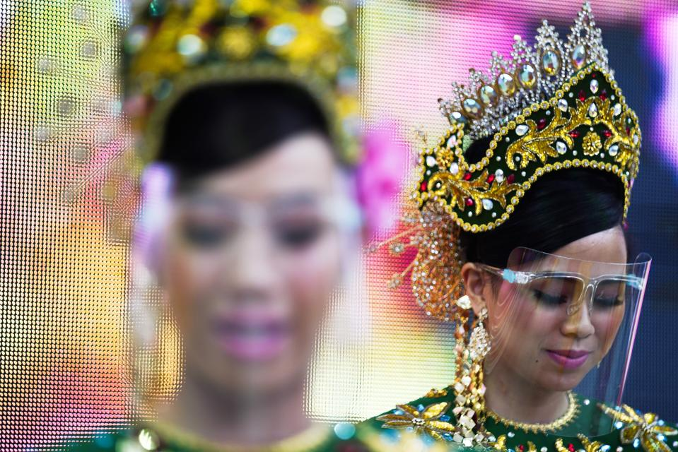Dancers from Malaysia's pavilion perform wearing face shields due to the coronavirus at Expo 2020, in Dubai, United Arab Emirates, Sunday, Oct. 3, 2021. (AP Photo/Jon Gambrell)