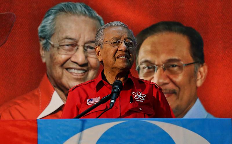 Pakatan Harapan's Langkawi candidate Tun Dr Mahathir Mohamad gives a speech the night before Polling Day in Ho Peng Hall Kuah