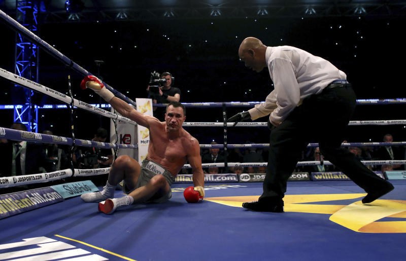 Ukrainian boxer Wladimir Klitschko is knocked down by British boxer Anthony Joshua, during their fight for Joshua's IBF and the vacant WBA Super World and IBO heavyweight titles, at Wembley Stadium, in London, Saturday, April 29, 2017. (Nick Potts/PA via AP)