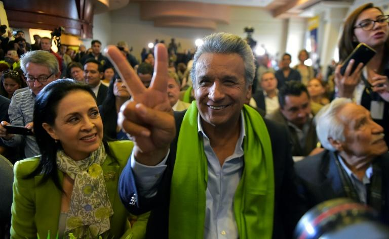 The Ecuadorean presidential candidate of the ruling Alianza PAIS party, Lenin Moreno, next to his wife Rocio Gonzalez (L), listens to the first results of the runoff election, in Quito on April 2, 2017