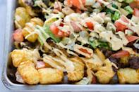 """<p>Not familiar with """"totchos""""? It's just a combination of tater tots and nachos—and only the best thing ever.</p><p><strong><a href=""""https://thepioneerwoman.com/food-and-friends/cheeseburger-totchos/"""" rel=""""nofollow noopener"""" target=""""_blank"""" data-ylk=""""slk:Get the recipe"""" class=""""link rapid-noclick-resp"""">Get the recipe</a>.</strong></p><p><strong><a class=""""link rapid-noclick-resp"""" href=""""https://go.redirectingat.com?id=74968X1596630&url=https%3A%2F%2Fwww.walmart.com%2Fip%2FThe-Pioneer-Woman-Vintage-Floral-4-Piece-Dinner-Plate-Set%2F55467844&sref=https%3A%2F%2Fwww.thepioneerwoman.com%2Ffood-cooking%2Fmeals-menus%2Fg36004463%2Fmemorial-day-appetizers%2F"""" rel=""""nofollow noopener"""" target=""""_blank"""" data-ylk=""""slk:SHOP PLATES"""">SHOP PLATES</a></strong></p>"""