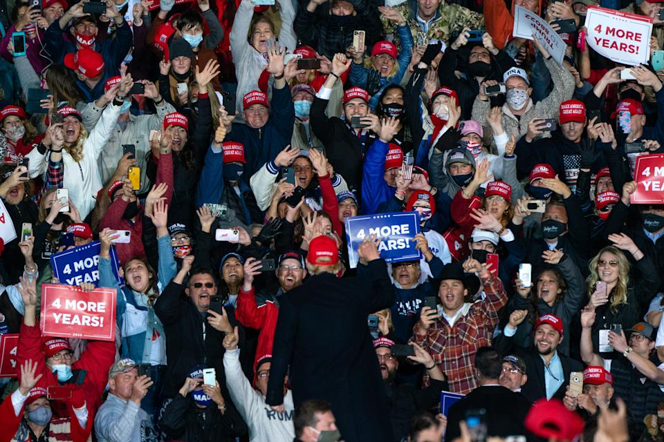 Donald Trump mobbed by supporters at a rally.