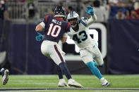 Houston Texans quarterback Davis Mills (10) is pressured by Carolina Panthers linebacker Haason Reddick (43) during the second half of an NFL football game Thursday, Sept. 23, 2021, in Houston. (AP Photo/Eric Christian Smith)