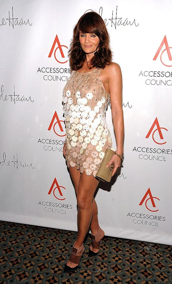 "Supermodel Helena Christensen once again proves how fashion-forward she is in a dazzling dress and funky footwear. Dimitrios Kambouris/<a href=""http://www.wireimage.com"" target=""new"">WireImage.com</a> - November 3, 2008"