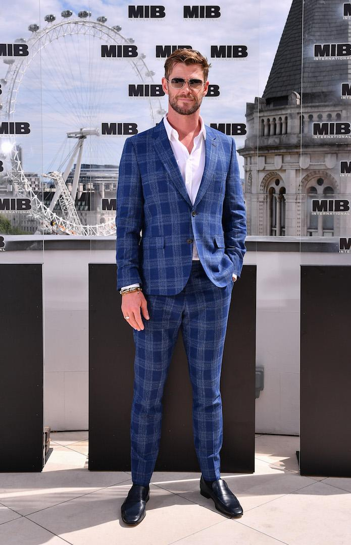 On June 2, Chris Hemsworth looked dapper in a Paul Smith checked suit teamed with sunnies. <em>[Photo: Getty]</em>