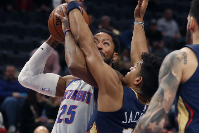 New Orleans Pelicans guard Frank Jackson (15) reaches in on Detroit Pistons guard Derrick Rose (25) during the first half of an NBA basketball game, Monday, Jan. 13, 2020, in Detroit. (AP Photo/Carlos Osorio)