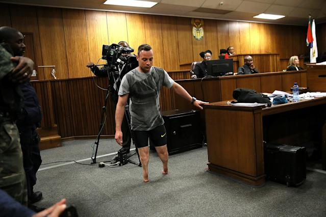 Paralympic gold medalist Oscar Pistorius walks across the courtroom without his prosthetic legs during the third day of his resentencing hearing for the 2013 murder of his girlfriend Reeva Steenkamp in the North Gauteng High Court in Pretoria, South Africa June 15, 2016. REUTERS/Alon Skuy/Pool