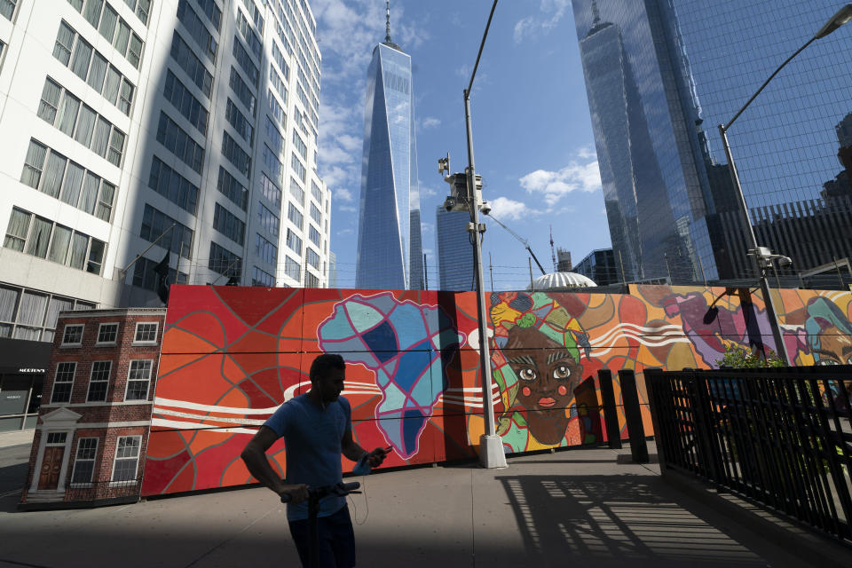 Behind a colorful mural the Port Authority police have a temporary facility at the World Trade Center, Wednesday, Sept. 8, 2021 in New York. A partnership led by Brookfield Properties and Silverstein Properties will develop the site as a 900-foot (270-meter) tower with office and retail space in addition to 1,325 apartments. Two decades after its destruction in the Sept. 11 terrorist attacks, the work to rebuild the World Trade Center complex remains incomplete. (AP Photo/Mark Lennihan)