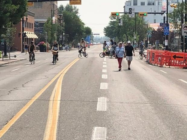 Calgarians stroll through Inglewood on the first Car Free Sunday on Aug. 1. The initiative will extend throughout the month of August. (Thomas Laberge/CBC - image credit)