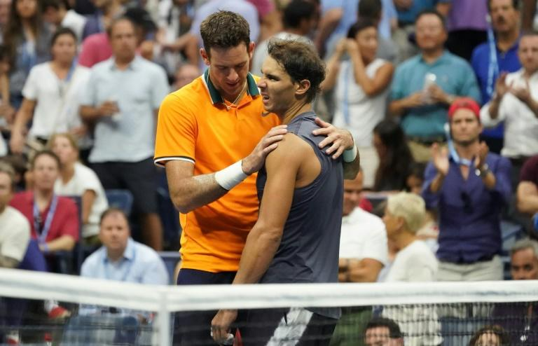 It's over: Rafael Nadal is consoled by Juan Martin del Potro