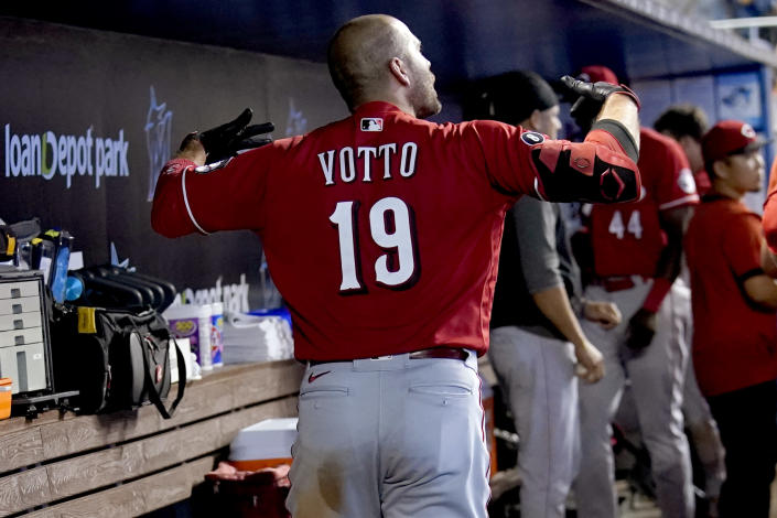 Cincinnati Reds' Joey Votto (19) reacts in the dugout after flying out during the ninth inning of a baseball game against the Miami Marlins, Sunday, Aug. 29, 2021, in Miami. The Marlins won 2-1. (AP Photo/Lynne Sladky)