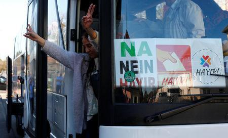 A Kurdish woman flashes a victory sign as she arrives with a group of some 30 Turks of Kurdish descent to vote at the Turkish consulate in Huerth near Cologne, Germany March 27, 2017. REUTERS/Wolfgang Rattay