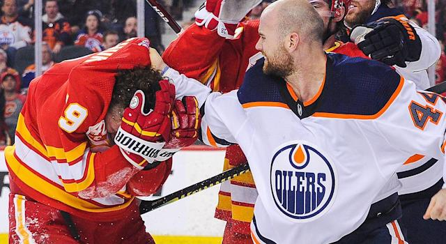 Zack Kassian #44 of the Edmonton Oilers fights Matthew Tkachuk #19 of the Calgary Flames during an NHL game at Scotiabank Saddledome on January 11, 2020 in Calgary, Alberta, Canada. (Photo by Derek Leung/Getty Images)