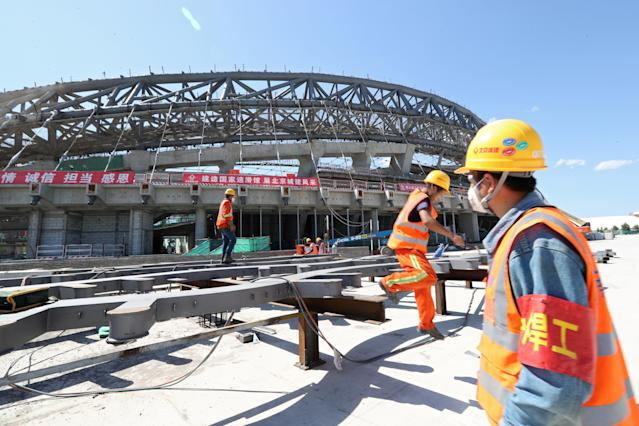 Workers are seen at the construction site of the National Speed Skating Oval, one of the venues for the 2022 Winter Olympics, in Beijing, China May 21, 2019. Picture taken May 21, 2019. China Daily via REUTERS ATTENTION EDITORS - THIS IMAGE WAS PROVIDED BY A THIRD PARTY. CHINA OUT. NO COMMERCIAL OR EDITORIAL SALES IN CHINA.