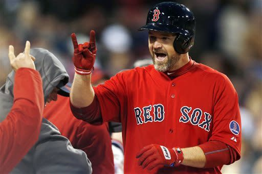 Boston Red Sox's David Ross celebrates his solo home in the second inning of a baseball game against the Houston Astros in Boston, Friday, April 26, 2013. (AP Photo/Michael Dwyer)