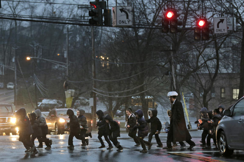 A group of orthodox jewish children cross the street in Monsey, N.Y., Monday, Dec. 30, 2019. (Photo: Seth Wenig/AP)