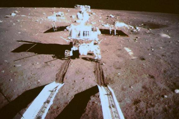 """China's lunar rover Yutu (""""Jade Rabbit"""") is seen by a camera on the country's Chang'e 3 lander after both successfully landed on the moon together on Dec. 14, 2013. It is China's first lunar rover mission and the first soft-landing on the moon"""