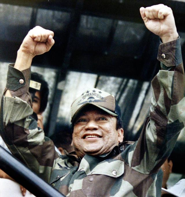 <p>Panamanian military strongman Gen. Manuel Noriega raises his fists to acknowledge the crowd's cheers during a Dignity Battalion rally in Panama City, May 20, 1988. (AP Photo/John Hopper) </p>