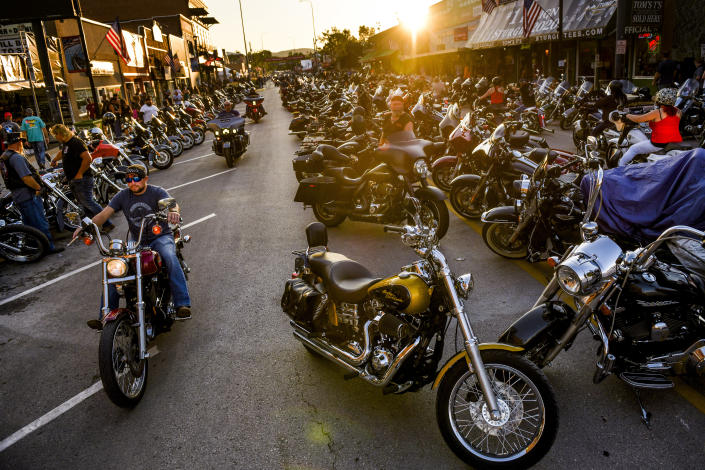 Motorcyclists drive down Main Street during the 80th Annual Sturgis Motorcycle Rally on August 7, 2020 in Sturgis, South Dakota. (Michael Ciaglo/Getty Images)