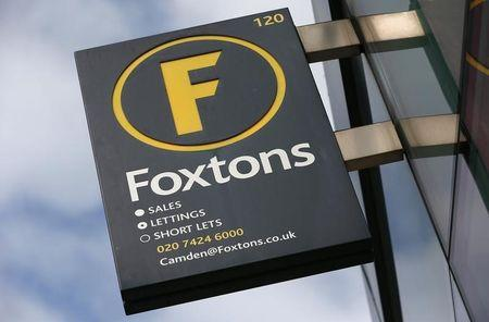 A Foxtons estate agent sign is seen outside a branch in north London