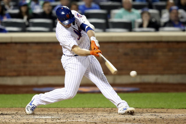 New York Mets' Pete Alonso hits an RBI-single during the eighth inning of a baseball game against the Philadelphia Phillies, Friday, Sept. 6, 2019, in New York. (AP Photo/Mary Altaffer)