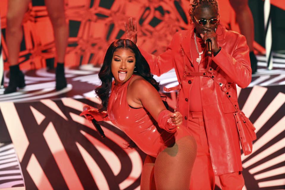 """This image released by NBC shows Megan Thee Stallion, center, and Young Thug performing on """"Saturday Night Live"""" in New York on Oct. 3, 2020. (Will Heath/NBC via AP)"""