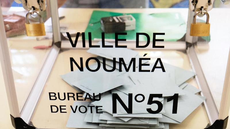 New Caledonia chooses to remain French in tight referendum