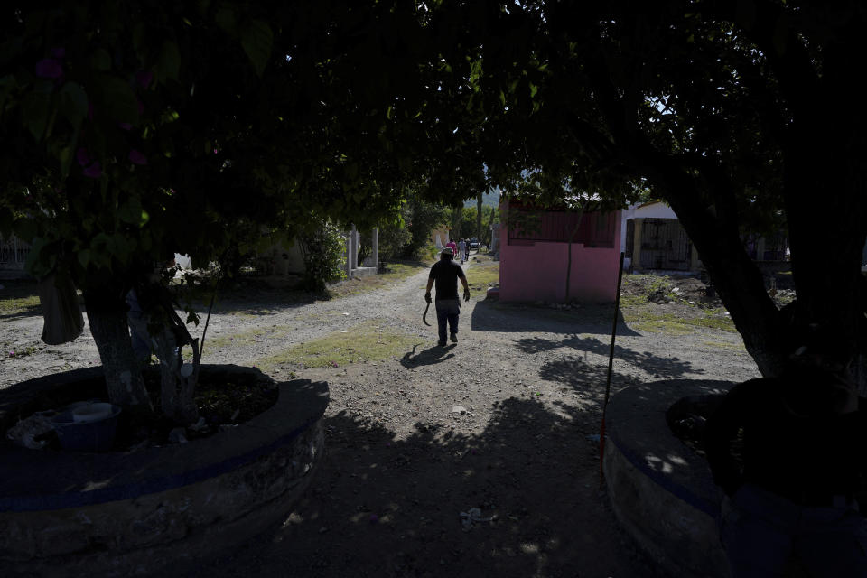 A volunteer joins the sixth National Search Brigade for missing people at a cemetery in Jojutla, Mexico, Monday, Oct. 11, 2021. The government's registry of Mexico's missing has grown more than 20% in the past year and now approaches 100,000. (AP Photo/Fernando Llano)
