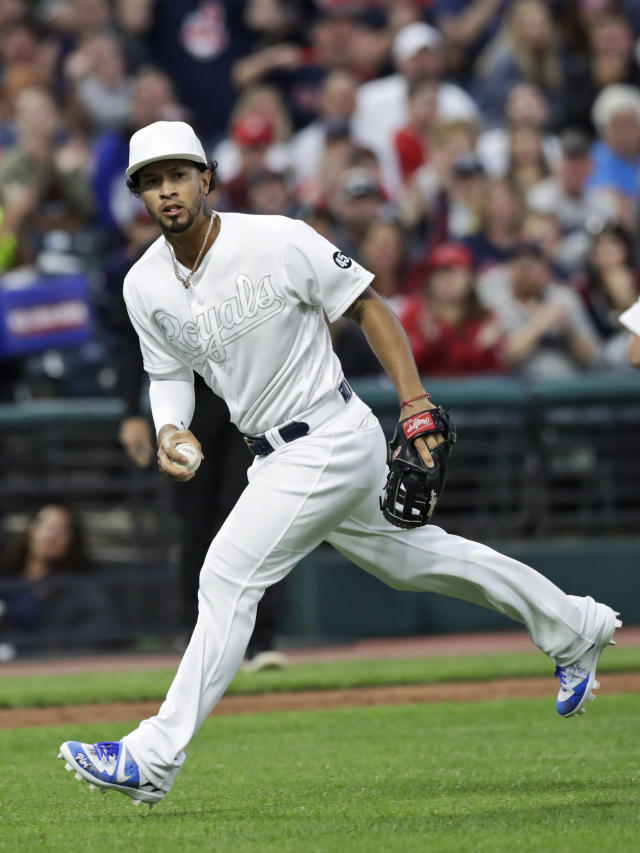 Kansas City Royals' Cheslor Cuthbert looks toward first base but can't make the throw to get Cleveland Indians' Mike Freeman in the third inning in a baseball game, Saturday, Aug. 24, 2019, in Cleveland. Freeman was safe at first and Oscar Mercado scored. (AP Photo/Tony Dejak)