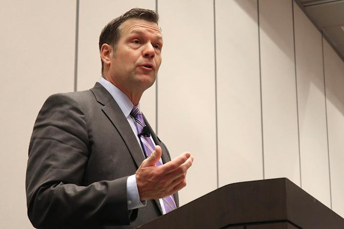 In this Feb. 1, 2020 file photo, former Kansas Secretary of State Kris Kobach, a candidate for the U.S. Senate, answers a question during a debate in Olathe, Kan. Critics of U.S. Rep. Roger Marshall, R-Kan. on the political right are working to hobble the western Kansas congressman's bid for the U.S. Senate in the final three months of a primary campaign as he fights to overcome conservative immigration hardliner Kobach in a crowded field. (AP Photo/John Hanna File)