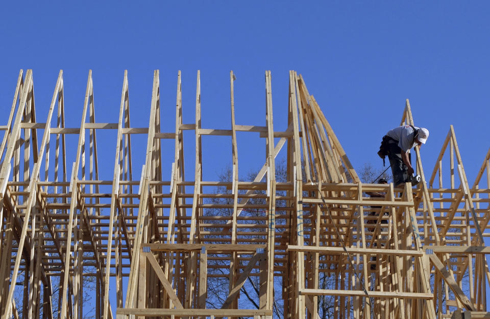 In this  Friday, March 29, 2013, photo, a worker helps frame a new home under construction in Matthews, N.C. U.S. homebuilders are concerned that limited land and rising costs for building materials and labor will slow sales in the short term.   (AP Photo/Chuck Burton)