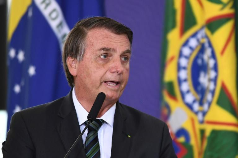 Brazilian President Jair Bolsonaro, who has said he is not likely to get a vaccine himself, delivers a speech during the launch of the national vaccination plan against the novel coronavirus Covid-19 in Brasilia December 16, 2020