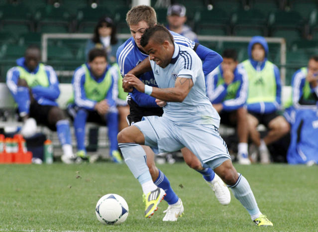 Sporting Kansas City's Kevin Ellis, front, fights for the ball with Montreal Impact's Justin Braun during a soccer match at the Walt Disney World Pro Soccer Classic, Sunday, Feb. 26, 2012, in Lake Buena Vista, Fla. (AP Photo/Reinhold Matay)