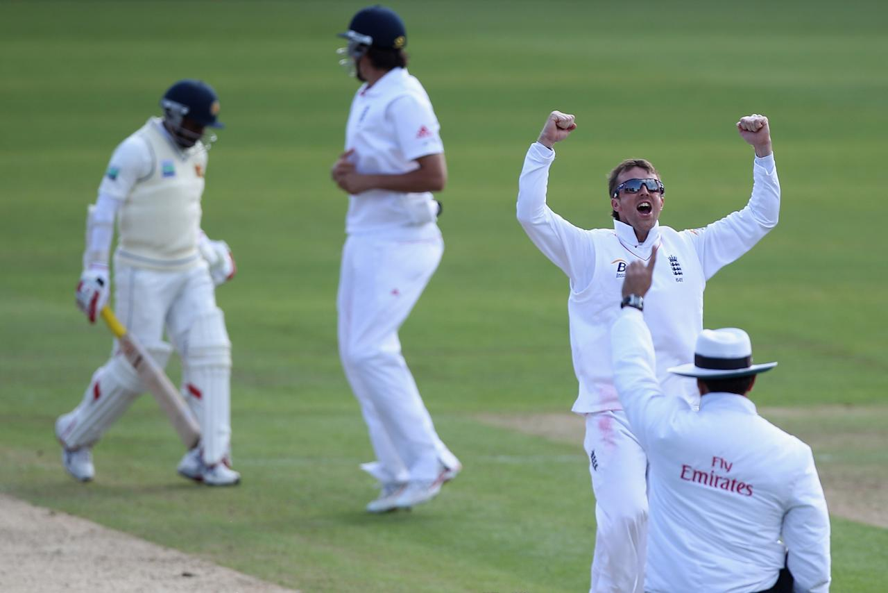CARDIFF, WALES - MAY 30: Graeme Swann (R) of England celebrates trapping  Rangana Herath (L) lbw during day five of the 1st npower test match between England and Sri Lanka at the Swalec Stadium  on May 30, 2011 in Cardiff, Wales.  (Photo by Michael Steele/Getty Images)