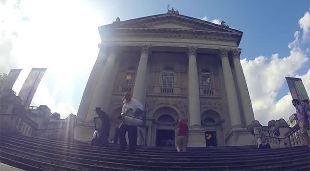 The men run down the stairs of the gallery, where they try to convince the fleeing crowds that the heist was a prank. Photo: YouTube/Trollstation