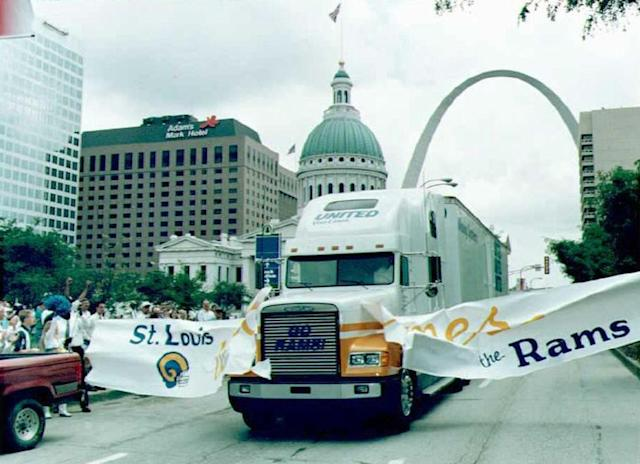 It was all smiles and fanfare in St. Louis as moving trucks brought in the Rams' equipment from Los Angeles in June of 1995. (Getty Images)