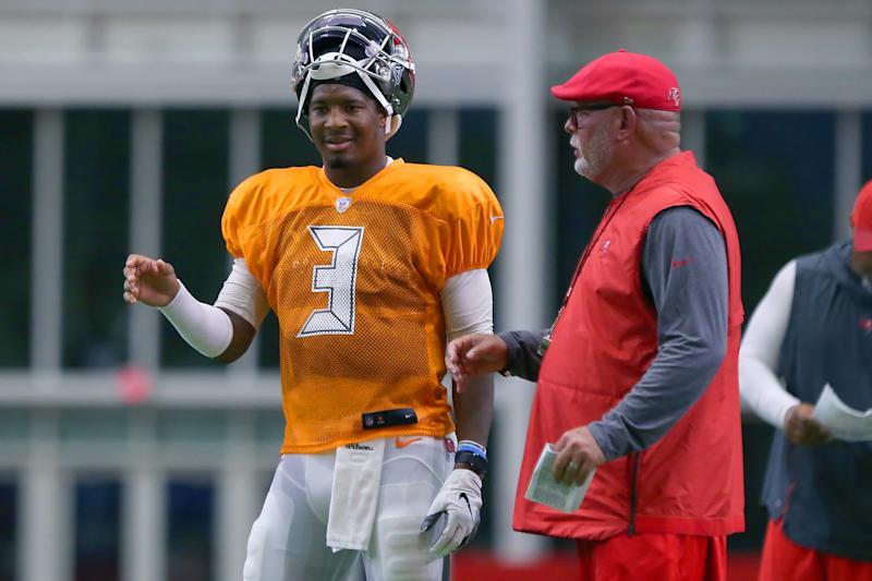 Tampa Bay coach Bruce Arians, right, said there's been no thought to benching Jameis Winston. (Getty Images)