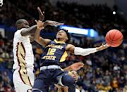 <p>Ja Morant #12 of the Murray State Racers attempts a shot against Christ Koumadje #21 of the Florida State Seminoles in the first half during the second round of the 2019 NCAA Men's Basketball Tournament at XL Center on March 23, 2019 in Hartford, Connecticut. (Photo by Rob Carr/Getty Images) </p>