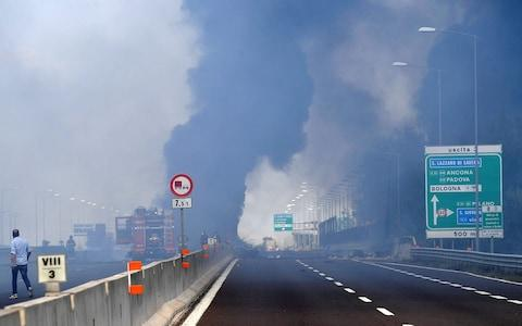 Firefighters work on the motorway - Credit: REUTERS