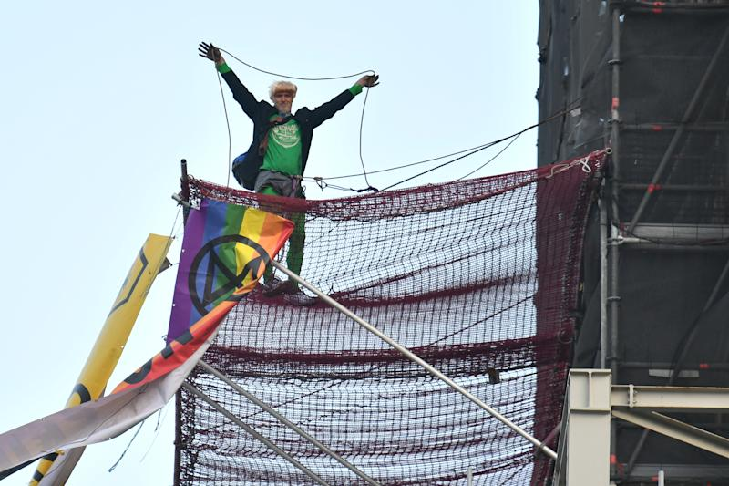 An Extinction Rebellion protester who has scaled the scaffolding surrounding Big Ben at the Houses of Parliament, Westminster, London. (Photo by Dominic Lipinski/PA Images via Getty Images)