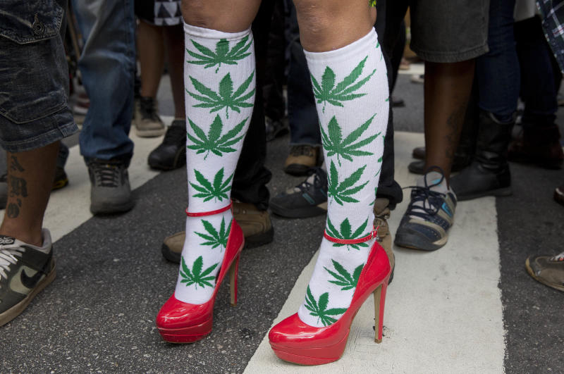 A woman wears socks with drawings of cannabis leaf at a legalization of marijuana march in Sao Paulo, Brazil, Saturday, April 26, 2014. Brazilian police say about 2,000 people have gathered in downtown Sao Paulo in a demonstration demanding the legalization of the production and sale of marijuana in Latin America's largest country. (AP Photo/Andre Penner) (AP Photo/Andre Penner)