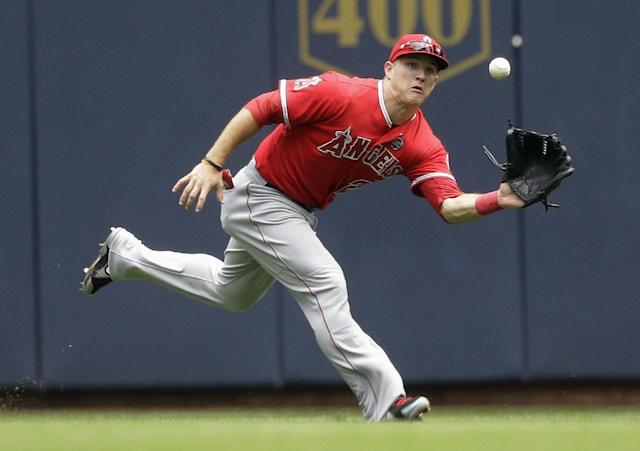Los Angeles Angels center fielder Mike Trout makes a running catch on a ball hit by Milwaukee Brewers' Jonathan Lucroy during the first inning of a baseball game Sunday, Sept. 1, 2013, in Milwaukee. (AP Photo/Morry Gash)