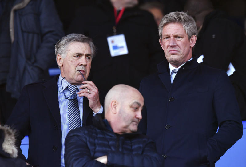 Everton's new manager Carlo Ancelotti, left, and director of football Marcel Brands in the stands during the English Premier League soccer match between Everton and Arsenal at Goodison Park, Liverpool, England, Saturday, Dec. 21, 2019. (Anthony Devlin/PA via AP)