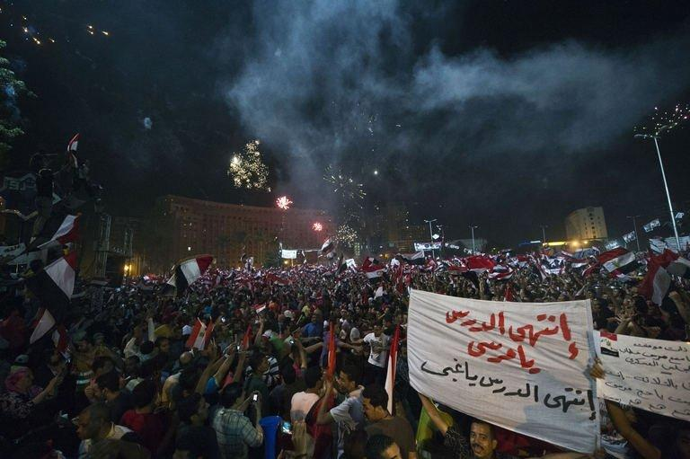 People celebrate at Cairo's Tahrir Square after the announcement that President Morsi was being toppled, on July 3, 2013