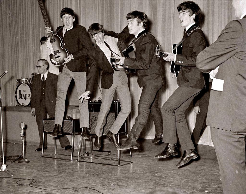"The original British Invasion began when the four mop-topped members of The Beatles sent droves of teenage girls into hysterics when they appeared on ""The Ed Sullivan Show"" for the first stateside performance in February 1964. Over the next six years, their sound evolved from sugary sweet tunes like ""I Want to Hold Your Hand"" to the more experimental, rock-driven ""I Am the Walrus"" to the wistful ballad ""Yesterday."" The group broke up in 1970, but not before they changed music history forever by scoring dozens of U.S. hits, and winning a shelf full of Grammy Awards, even some in 1997 for an album that used late singer John Lennon's voice from earlier records almost two decades after he was fatally shot in 1980. And the Fab Four regularly land atop lists of the greatest artist of all time, such as the one by <em>Rolling Stone</em> magazine."