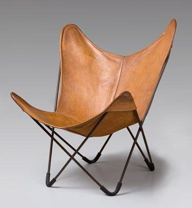 """<p>You probably had one in your dorm room, but did you know this folding chair has quite the design past? It was designed in Buenos Aires in 1938 by the design collective Grupo Austral, a group of three architects who met while working for Le Corbusier. The chair caught the attention of curators at MoMA, who requested a model. In 1947, <a href=""""http://www.knoll-int.com/for-home/butterfly-chair-anniversary-edition"""" rel=""""nofollow noopener"""" target=""""_blank"""" data-ylk=""""slk:Knoll"""" class=""""link rapid-noclick-resp"""">Knoll</a> began carrying it, swapping out the original black legs for polished chrome—but stopped production in 1951. Now, versions of the chair style can be found everywhere from CB2 to Target. </p>"""