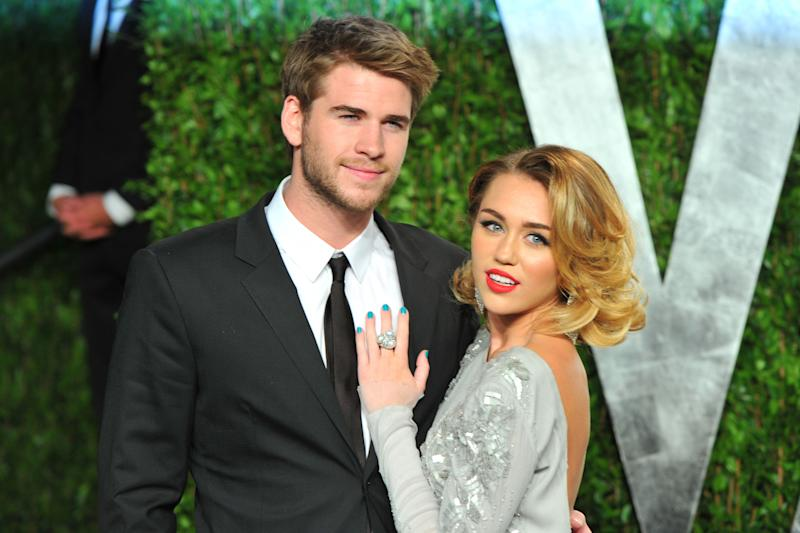 Miley Cyrus and ex-husband Liam Hemsworth pictured at the Vanity Fair after party in 2012